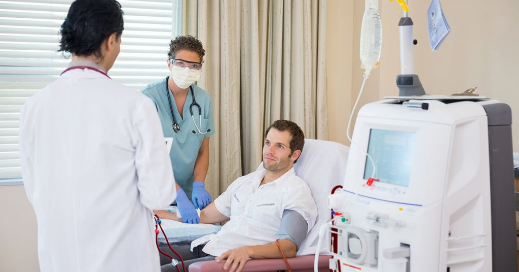 Medical team with patient undergoing renal dialysis treatment in hospital room; blog: 8 Coping Tips for Dialysis Patients
